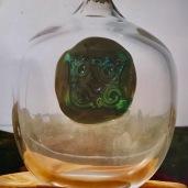 Vaso con gli occhi della dea Madre Terra in verde Smeraldo con oro zecchino Murano Venezia